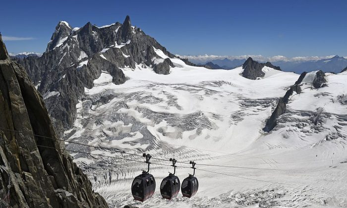 Panoramic Mont-Blanc cable car linking the Aiguille du Midi peak to the Helbronner peak in Italy, above the seracs and crevasses of the Glacier des Géants on August 5, 2015. (Glacier of the Giants).  (PHILIPPE DESMAZES/AFP/Getty Images)