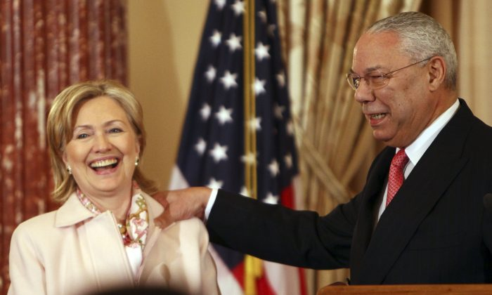 Former U.S. Secretary of State Colin Powell (R)  with Hillary Clinton on Dec. 7, 2009 in Washington, DC. (Win McNamee/Getty Images)