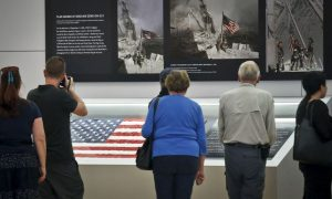 Flag That Firefighters Raised at Ground Zero Returns to WTC Site