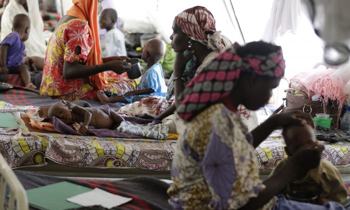 In this photo taken Monday Aug. 29, 2016. Women feed their malnourished children at a feeding centre run by Doctors Without Borders in Maiduguri, Nigeria. The whimpers from skeletally thin babies too weak to cry out are a harbinger of worse things to come: A quarter of the kids lucky enough to make it to this emergency feeding center are dying _ the latest victims of Boko Haram's Islamic insurgency. (AP Photo/Sunday Alamba)