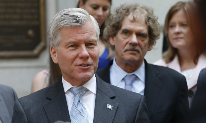 FILE - in this May 12, 2015 file photo, Former Virginia Gov. Bob McDonnell speaks outside the 4th U.S. Circuit Court of Appeals in Richmond, Va. after a hearing the appeal of his corruption conviction. Federal prosecutors say they are moving to drop corruption charges against McDonnell. U.S. Attorney Dana Boente's office said Thursday, Sept. 8, 2016, that prosecutors will not pursue another trial in light of the U.S. Supreme Court decision in June that overturned the former governor's corruption conviction.  (AP Photo/Steve Helber, File)