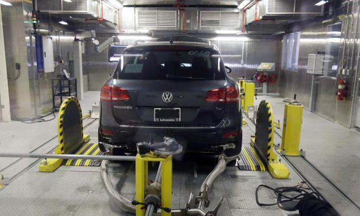 FILE - In this Oct. 13, 2015, file photo, a Volkswagen Touareg diesel is tested in the Environmental Protection Agency's cold temperature test facility in Ann Arbor, Mich. A Volkswagen engineer pleaded guilty Friday, Sept. 9, 2016, to one count of conspiracy in the company's emissions cheating scandal. James Robert Liang, of Newberry Park, Calif., entered the plea in U.S. District Court in Detroit. (AP Photo/Carlos Osorio, File)