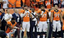 Colin Kaepernick Kneels for Anthem; 2 Rams Raise Fists in Protest