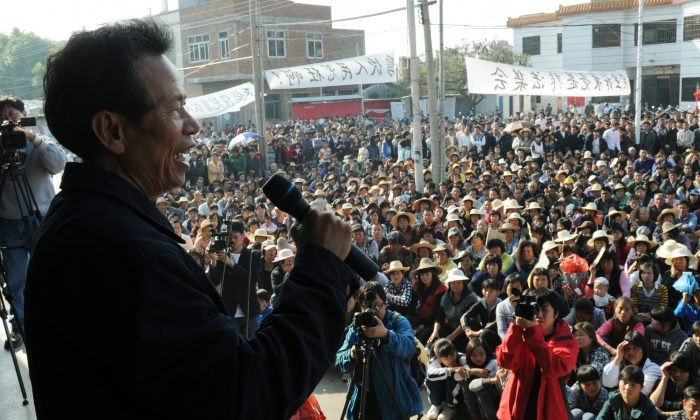 Village leader Lin Zulian delivered a speech at a rally over illegal land grabs in Wukan, Guangdong Province, on Dec. 21, 2011. Lin was sentenced on Sep. 8 on charge of corruption after three months of detention, and villagers have been protesting for his release since his arrest. (Mark Ralston/AFP/Getty Images)