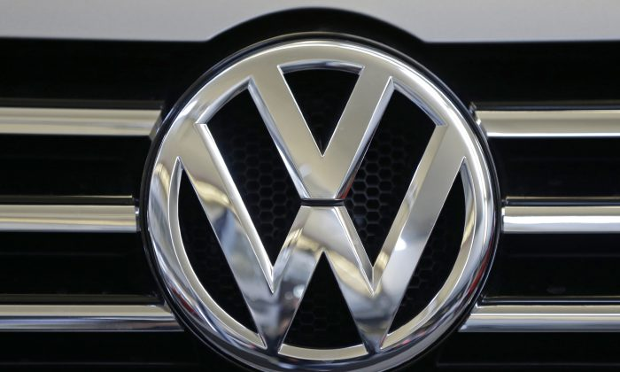 The Volkswagen logo on the grill of a Volkswagen on display in Pittsburgh on Feb. 14, 2013. (AP Photo/Gene J. Puskar)
