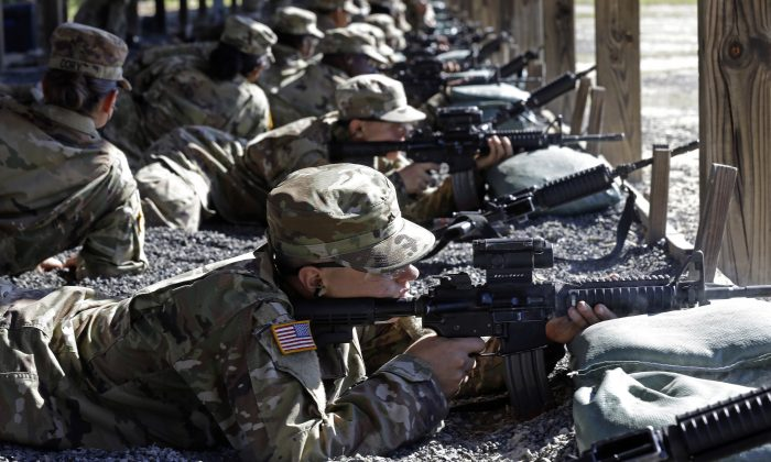 U.S. Army Private Austin Lewis fires his M-4 weapon while participating in live-fire marksmanship training at Fort Jackson, S.C., on Aug. 17, 2016. (AP Photo/Gerry Broome)