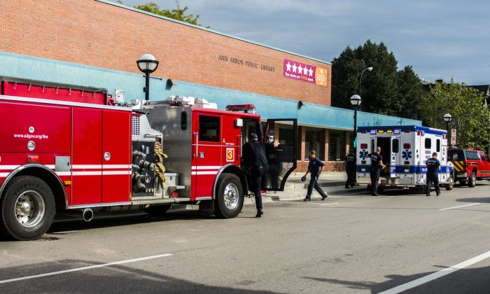 Ann Arbor police, firemen, and medical personnel respond to an overdose at the Ann Arbor District Library in Ann Arbor, Mich., on Sept. 9, 2014. (Katie McLean, The Ann Arbor News via AP)