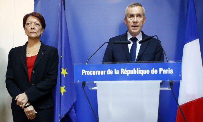 Paris Prosecutor Francois Molins (R), flanked with Director of the Judicial Police Mireille Ballestrazzi (L), addresses the media in Paris on Sept. 9, 2016. (AP Photo/Francois Mori)