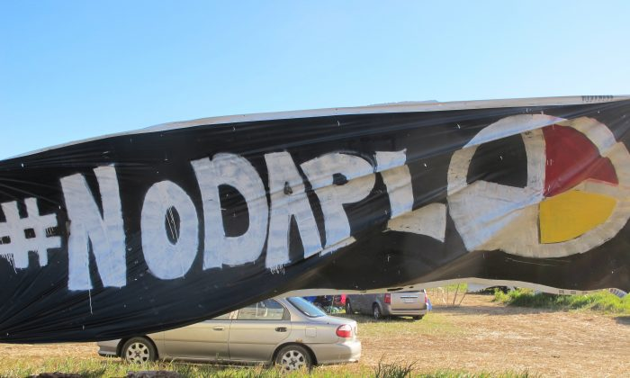 A banner protesting the Dakota Access oil pipeline is displayed at an encampment near North Dakota's Standing Rock Sioux reservation on Sept. 9, 2016. (AP Photo/James MacPherson)