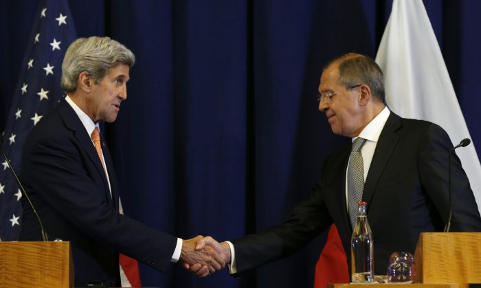 U.S. Secretary of State John Kerry (L) and Russian Foreign Minister Sergei Lavrov at the conclusion of a joint press conference following their meeting in Geneva, Switzerland, on Sept. 9, 2016. (Kevin Lamarque/Pool Photo via AP)