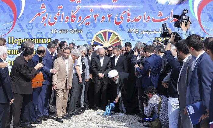 Supreme Leader Ali Khamenei's representative in Bushehr province (C-bottom) breaks ground in a ceremony to begin building Iran's second nuclear power plant in the southern port city of Bushehr, Iran, on Sept. 10, 2016. (Iranian Senior Vice-President's Office via AP)