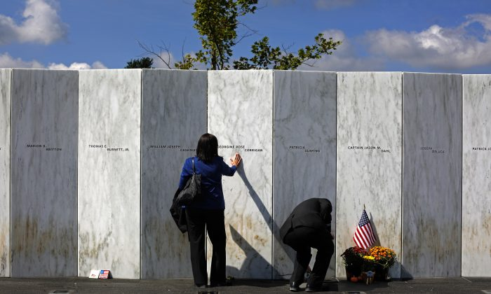 A visitor pauses at the Wall of Names after a Service of Remembrance at the Flight 93 National Memorial in Shanksville, Pa., on Sept. 11, 2015. (AP Photo/Gene J. Puskar)