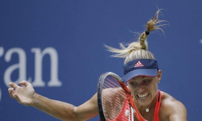 Angelique Kerber, of Germany, returns a shot to Karolina Pliskova, of the Czech Republic, during the women's singles final of the U.S. Open tennis tournament, Saturday, Sept. 10, 2016, in New York. (AP Photo/Julio Cortez)