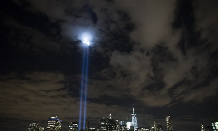 """The """"Tribute in Light"""" rises from the Lower Manhattan skyline as seen from the Brooklyn Heights Promenade, in the Brooklyn borough of New York City, on Sept. 7, 2016. (Drew Angerer/Getty Images)"""