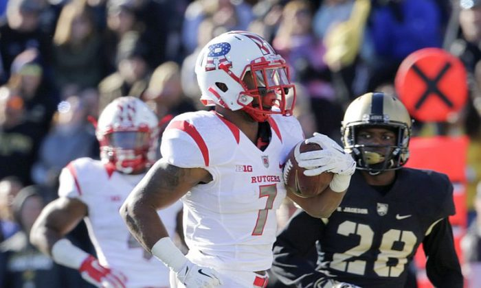 In this Nov. 21, 2015 file photo, Army's Brandon Jackson (28) pursues Rutgers running back Robert Martin (7) who scored a touchdown during the first half of an NCAA college football game in West Point, N.Y. . (AP Photo/Mike Groll, File)