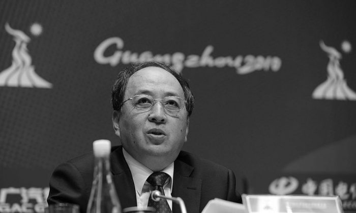 Xiao Tian speaks at a press conference at the media centre for the 16th Asian Games in Guangzhou on Nov. 10, 2010. (Peter Parks/AFP/Getty Images)