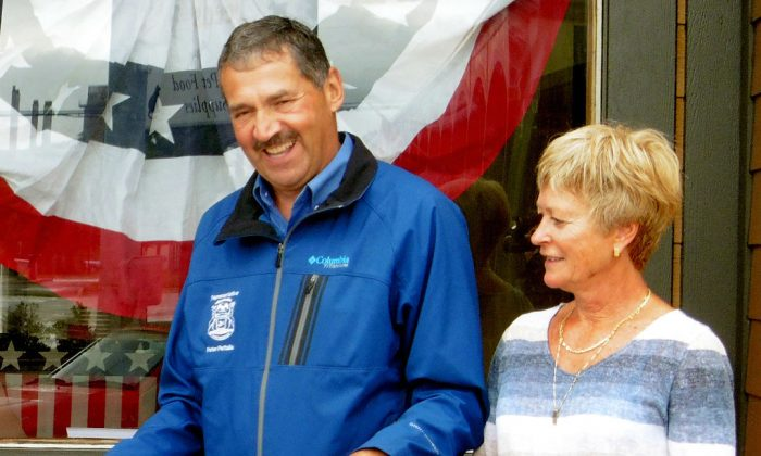Michigan State Rep. Peter Pettalia, R-Presque Isle, with his wife, Karen, during a ribbon-cutting ceremony to open the local office for 1st Congressional candidate Jason Allen, in Alpena, Mich., on July 15, 2016. (Tyler Winowiecki/The Alpena News via AP)