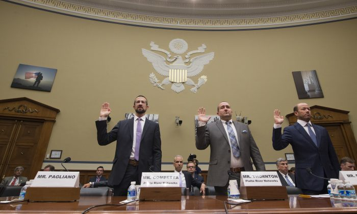 Witnesses, from left, Paul Combetta, Platte River Networks, Bill Thornton, Platte River Networks, and Justin Cooper are sworn in on Capitol Hill in Washington, Tuesday, Sept. 13, 2016, prior to testifying before the House Oversight and Government Reform Committee hearing on 'Examining Preservation of State Department Records.' Bryan Pagliano, former senior advisrr, Information Resource Management, State Department of State did not appear, empty seat at left.  (AP Photo/Molly Riley)