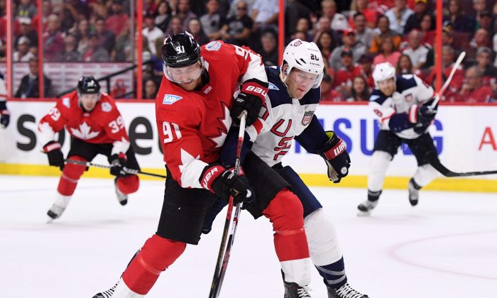Team Canada's Steven Stamkos fights to hold on to the puck against Team USA's Ryan Suter in pre-tournament World Cup of Hockey action in Ottawa on Sept. 10, 2016. (The Canadian Press/Sean Kilpatrick)