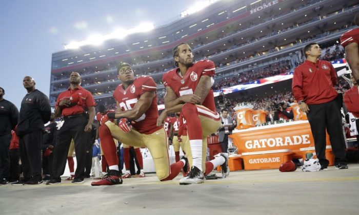 San Francisco 49ers safety Eric Reid (35) and quarterback Colin Kaepernick (7) kneel during the national anthem before an NFL football game against the Los Angeles Rams in Santa Clara, Calif., Monday, Sept. 12, 2016. Politicians gave their opinion on Kaepernick on Sept. 28. (AP Photo/Marcio Jose Sanchez)