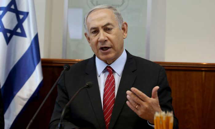 FILE - In this Sept. 11, 2016 file-pool photo, Israeli Prime Minister Benjamin Netanyahu gestures as he opens the weekly cabinet meeting at his Jerusalem office. The U.S. will provide Israel's military with $38 billion during the next 10 years, officials said Tuesday, Sept. 13, 2016, the largest batch of military assistance the U.S. has ever pledged to another country. Netanyahu's office confirmed in a brief statement that a deal had been reached, but offered no additional comment. (Gali Tibbon, Pool via AP, File)