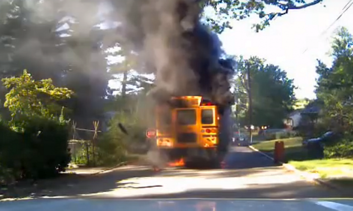 A screenshot from a dashboard camera video uploaded to YouTube shows the burning school bus in Prince George County, Maryland.  (Screenshot/YouTube)