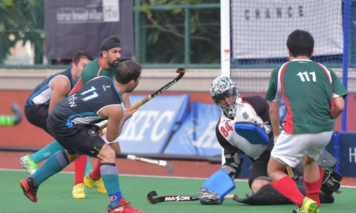 HKFC_A (blue) on the attack in their 12-0 win against KCC-A in the opening game of the Hong Kong Hockey Association, 2016 Premier Division campaign on Sunday Sept 11, 2016 to take them to top of the table. (Bill Cox/Epoch Times)