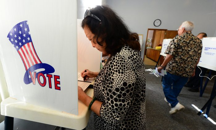 Robena Cheung votes at a polling station  in Monterey Park, Los Angeles County, on Nov. 6, 2012. Monterey Park is one of 6 cities in California's 49th Assembly District where Asian-Americans make up the majority of the population.  (FREDERIC J. BROWN/AFP/Getty Images)