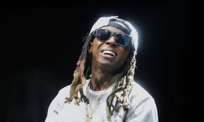 """Lil Wayne performs during Hot 97's """"Busta Rhymes & Friends: Hot For The Holidays"""" at the Prudential Center in Newark, N.J. (Photo by Brad Barket/Invision/AP)"""