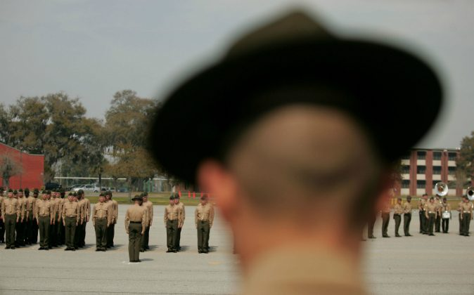 A United States Marine Corps drill instructor watches recruits on the parade deck during boot camp March 8, 2007 at Parris Island, South Carolina. The Department of Defense has asked Congress to increase the size of the Marine Corps by 27,000 troops and the Army by 65,000 over the next five years. An investigation has revealed that recruits were tormented with abuse by drill instructors. (Scott Olson/Getty Images)