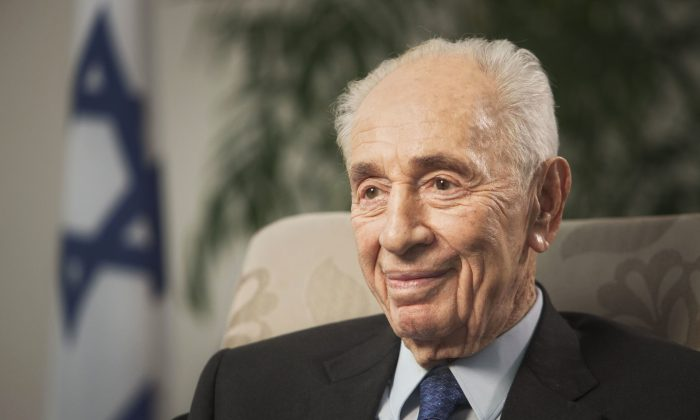FILE - In this Nov. 2, 2015 file photo, former Israeli President Shimon Peres speaks during an interview with The Associated Press in Jerusalem. Former Israeli President Shimon Peres on Tuesday suffered a stroke and was rushed to a hospital, where he was sedated and placed on a respirator ahead of a brain scan. (AP Photo/Dan Balilty, File)