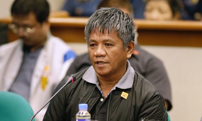 Former Filipino militiaman Edgar Matobato answers questions as he testifies before the Philippine Senate in Pasay, south of Manila, Philippines on Thursday Sept. 15, 2016. Matobato said that Philippine President Rodrigo Duterte, when he was still a city mayor, ordered him and other members of a squad to kill criminals and opponents in gangland-style assaults that left about 1,000 dead. (AP Photo/Aaron Favila)
