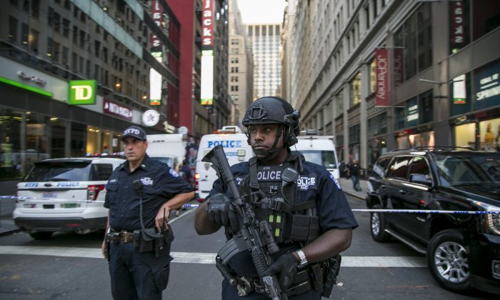 New York Police Officers are on the scene where a man