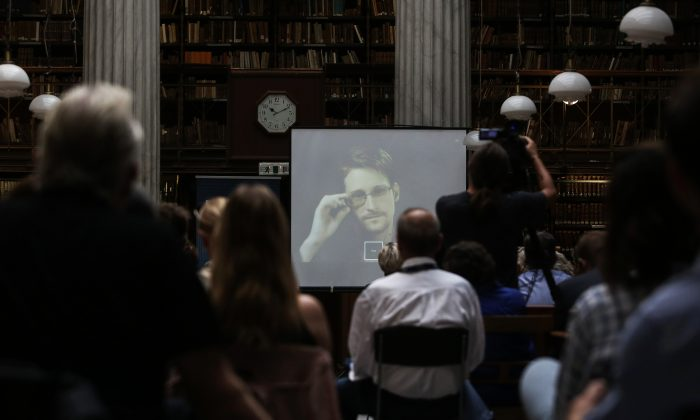 National Security Agency leaker Edward Snowden speaks via video link during the Athens Democracy Forum, organised by the New York Times, at the National Library in Athens, Sept. 16, 2016. (Kostas Baltas, InTime Sports via AP)