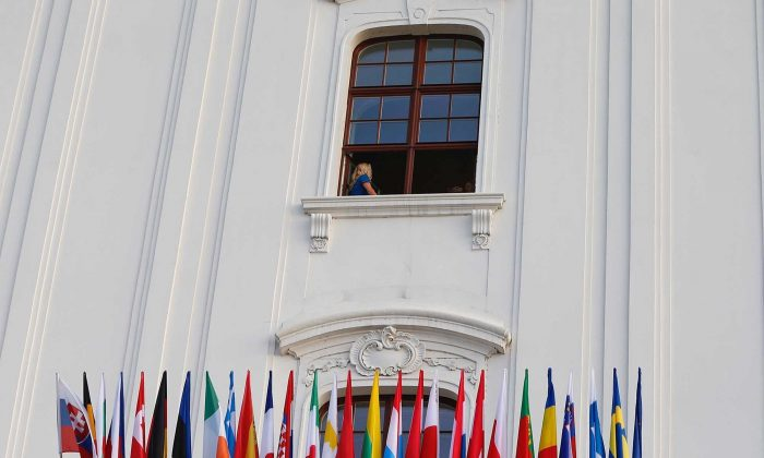 The flags of member states are placed on display before an EU summit at Bratislava Castle in Bratislava on Sept. 16, 2016. (AP Photo/Virginia Mayo)