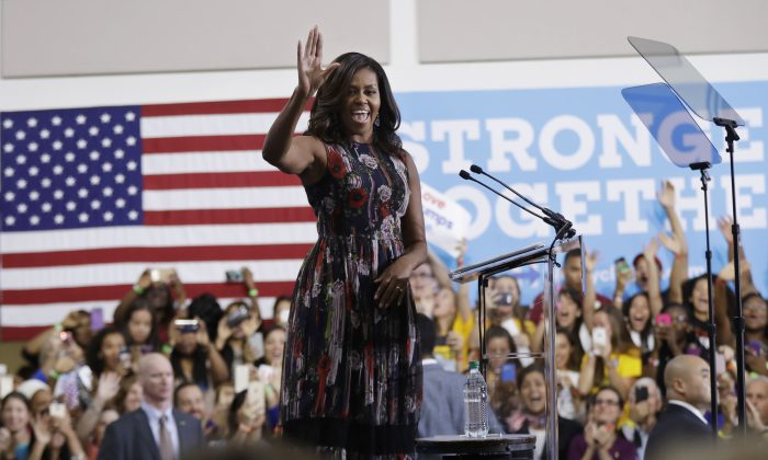 First lady Michelle Obama during a campaign rally in support of Democratic presidential candidate Hillary Clinton and vice presidential candidate, Sen. Tim Kaine at George Mason University in Fairfax, Va., on Sept. 16, 2016. (AP Photo/Manuel Balce Ceneta)