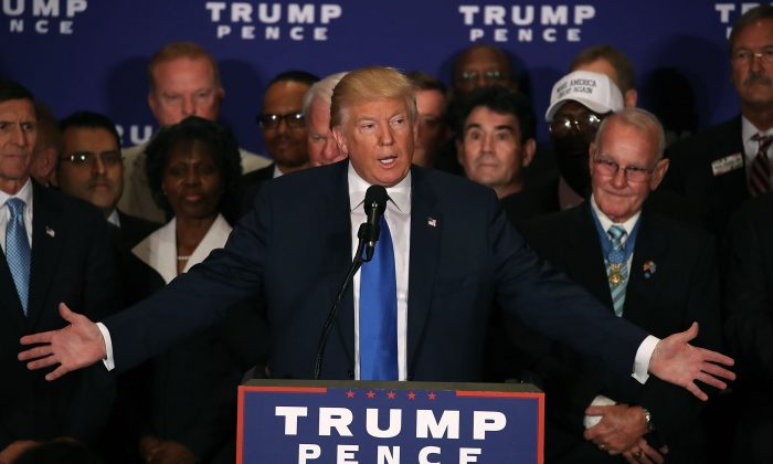 Surrounded by military veterans, US Republican presidential nominee Donald Trump says US President Barack Obama was born in the United States, during a campaign event at the Trump International Hotel, September 16, 2016 in Washington, DC. (Mark Wilson/Getty Images)