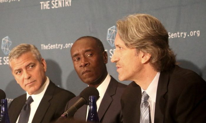 Actors George Clooney (L) and Don Cheadle (C) appear with author John Prendergast at the National Press Club, Sept. 14, to discuss the findings of a two-year investigation into the networks of corrupt South Sudan's senior officials. Clooney and Prendergast co-founded The Sentry and have an abiding interest in African issues. (Gary Feuerberg/Epoch Times)