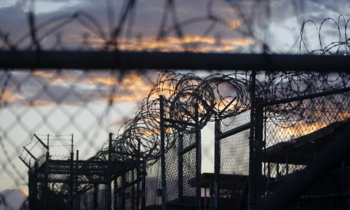Dawn arrives at the now closed Camp X-Ray, which was used as the first detention facility for al-Qaida and Taliban militants who were captured after the Sept. 11 attacks, at the Guantanamo Bay Naval Base, Cuba, on Nov. 21, 2013. (AP Photo/Charles Dharapak)
