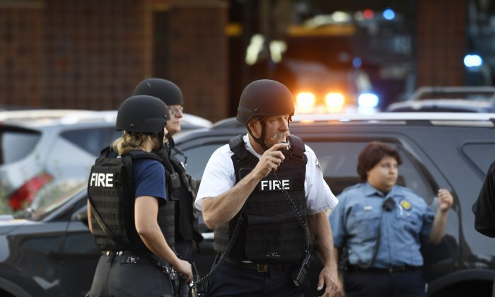 A Denver hospital complex was placed on lockdown Friday, Sept. 16, 2016, after a report that a man was seen carrying a rifle on the complex grounds. (Andy Cross/The Denver Post via AP)