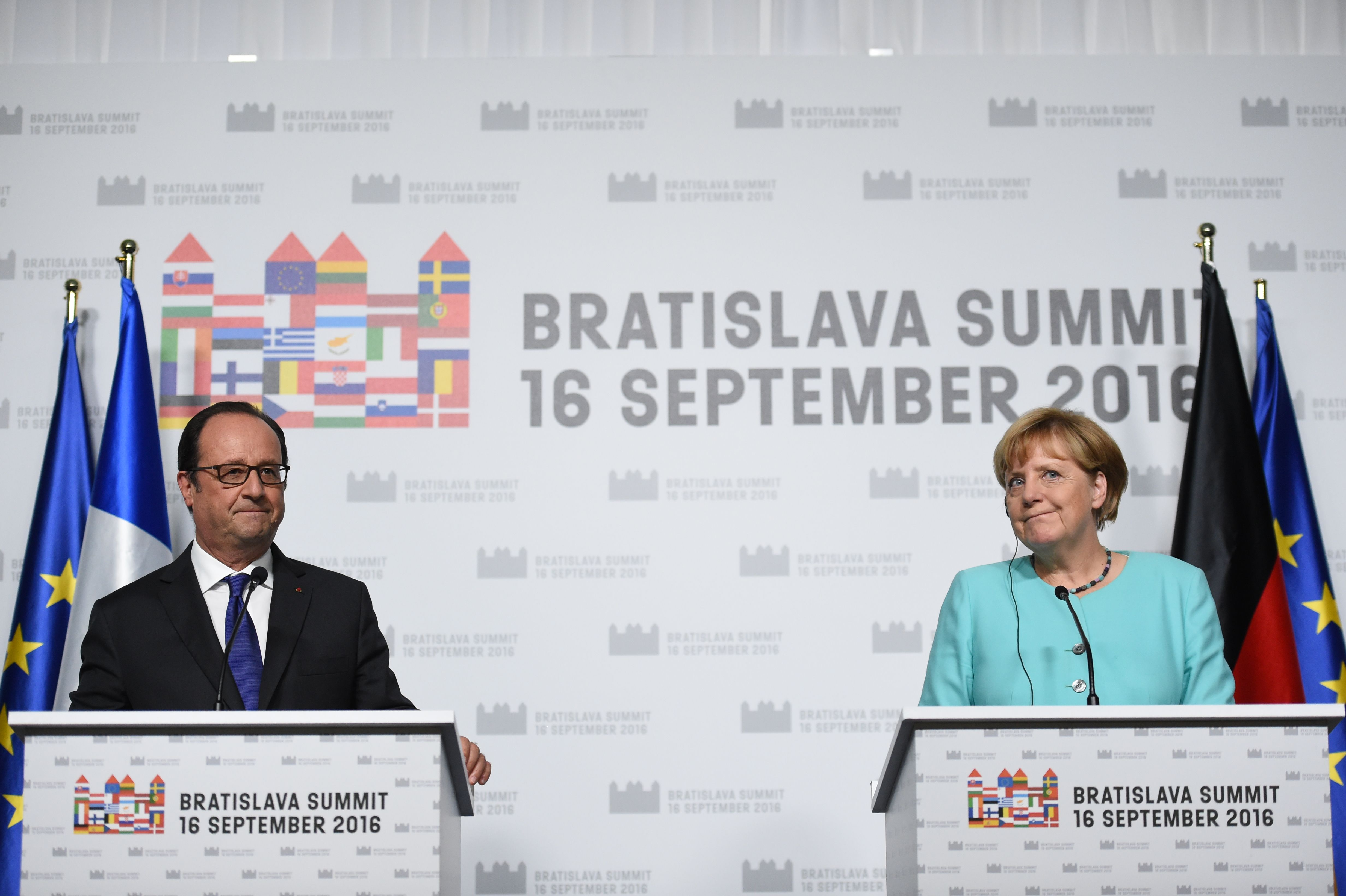 French President Francois Hollande (L) and German Chancellor Angela Merkel deliver a joint statement after the European Union Summit of 27 Heads of State or Government in Bratislava, Slovakia, on Sept. 16, 2016. (Stephane de Sakutin/AFP/Getty Images)