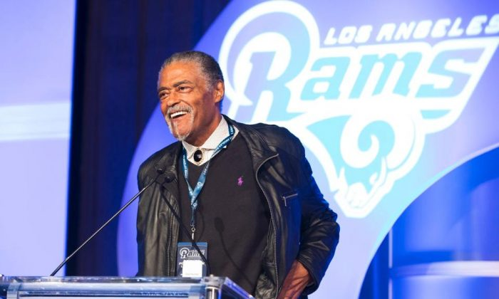 84 year-old Roosevelt Grier, a member of the fabled Fearsome Foursome, and now an ordained minister, gives the invocation at the Kick Off for Charity Luncheon, hosted by the Los Angeles rams Charitable Foundation. (Ric Tapia/LA Rams Foundation)