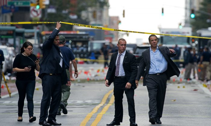 New York Gov. Andrew Cuomo (R) walks from the scene of an explosion in Manhattan's Chelsea neighborhood, in New York, on Sunday, Sept. 18, 2016, after an incident that injured passers-by Saturday night. (AP Photo/Craig Ruttle)