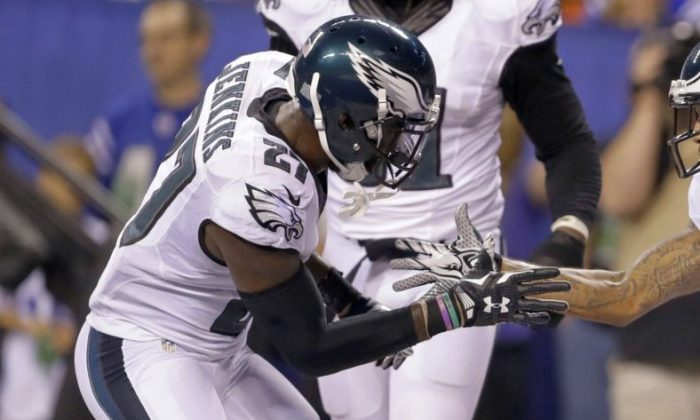 Philadelphia Eagles cornerback Nolan Carroll (22), right, celebrates an interception against the Indianapolis Colts with free safety Malcolm Jenkins (27) during the second half of an NFL preseason football game in Indianapolis, Saturday, Aug. 27, 2016. (AP Photo/Darron Cummings)