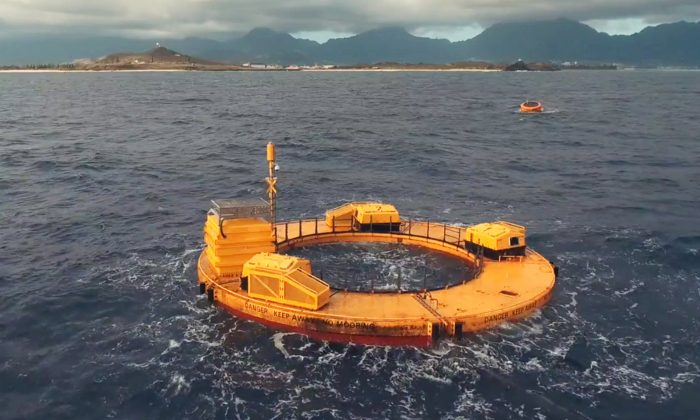This photo provided by Norwegian company Fred, shows the Lifesaver wave energy device, which is converting the movement of waves into electricity at the Navy's Wave Energy Test Site at at the Marine Corps base at Kaneohe Bay on Oahu in Hawaii, 2016. (Even Hjetland/Fred. Olsen via AP)