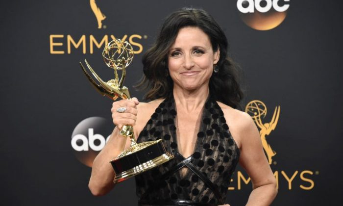 """Julia Louis-Dreyfus poses in the press room with the award for  outstanding lead actress in a comedy series for """"Veep"""" at the 68th Primetime Emmy Awards on Sunday, Sept. 18, 2016, at the Microsoft Theater in Los Angeles. (Photo by Phil McCarten/Invision for the Television Academy/AP Images)"""