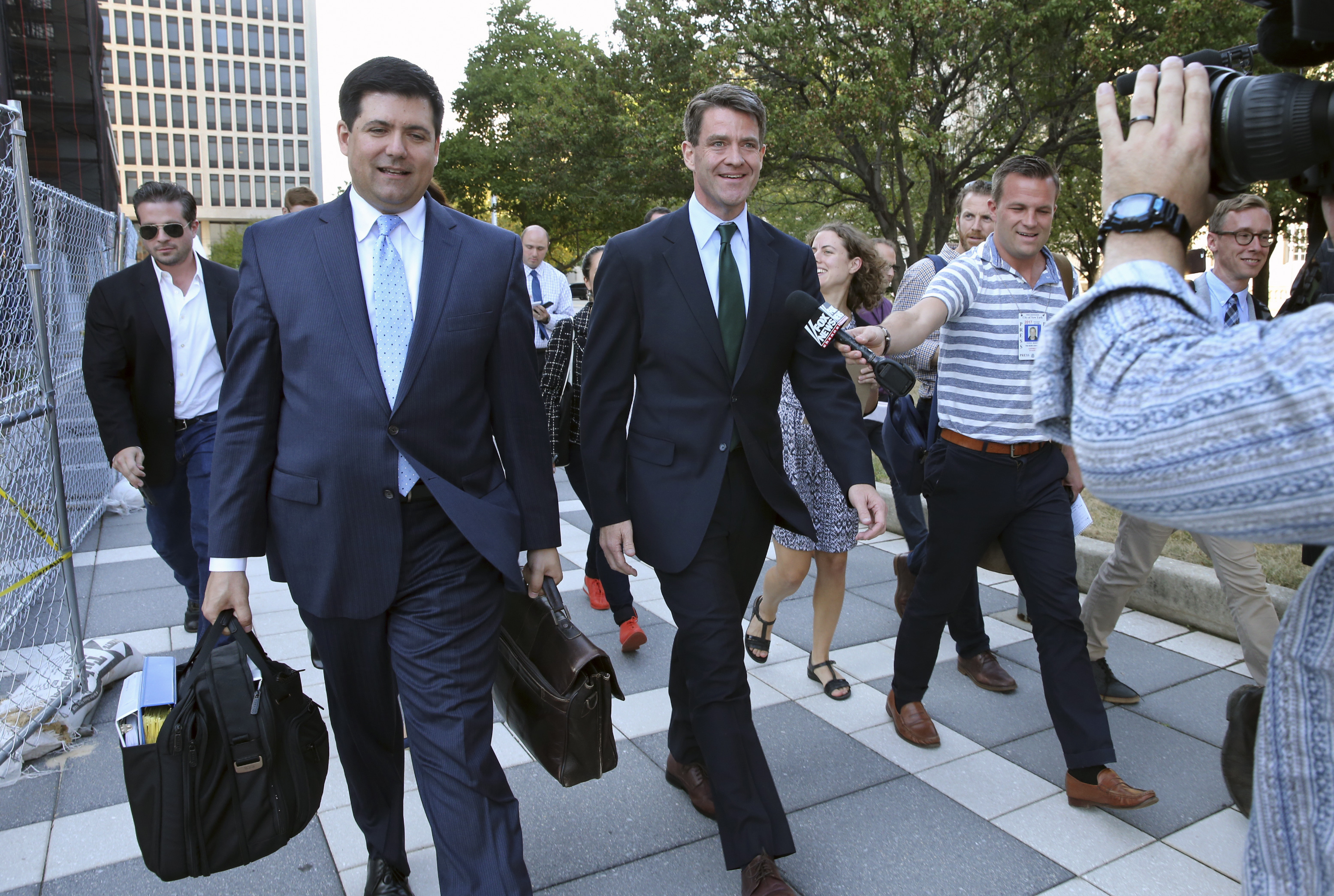 Bill Baroni (C) New Jersey Gov. Chris Christie's former top appointee at the Port Authority of New York and New Jersey, and his attorney Michael Baldassare, (center L) leave Federal Court after a hearing for jury selection in Newark, N.J., on Sept. 13, 2016. (AP Photo/Mel Evans)