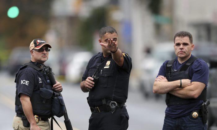 Police officers stand on Elizabeth Ave.,  in Linden, N.J., on Sept. 19, 2016. (AP Photo/Mel Evans)