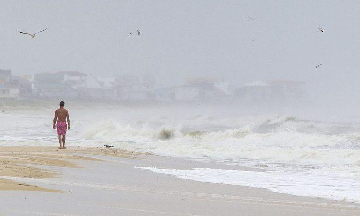 A man walks on a beach in Florida. (Mark Wallheiser/Getty Images)