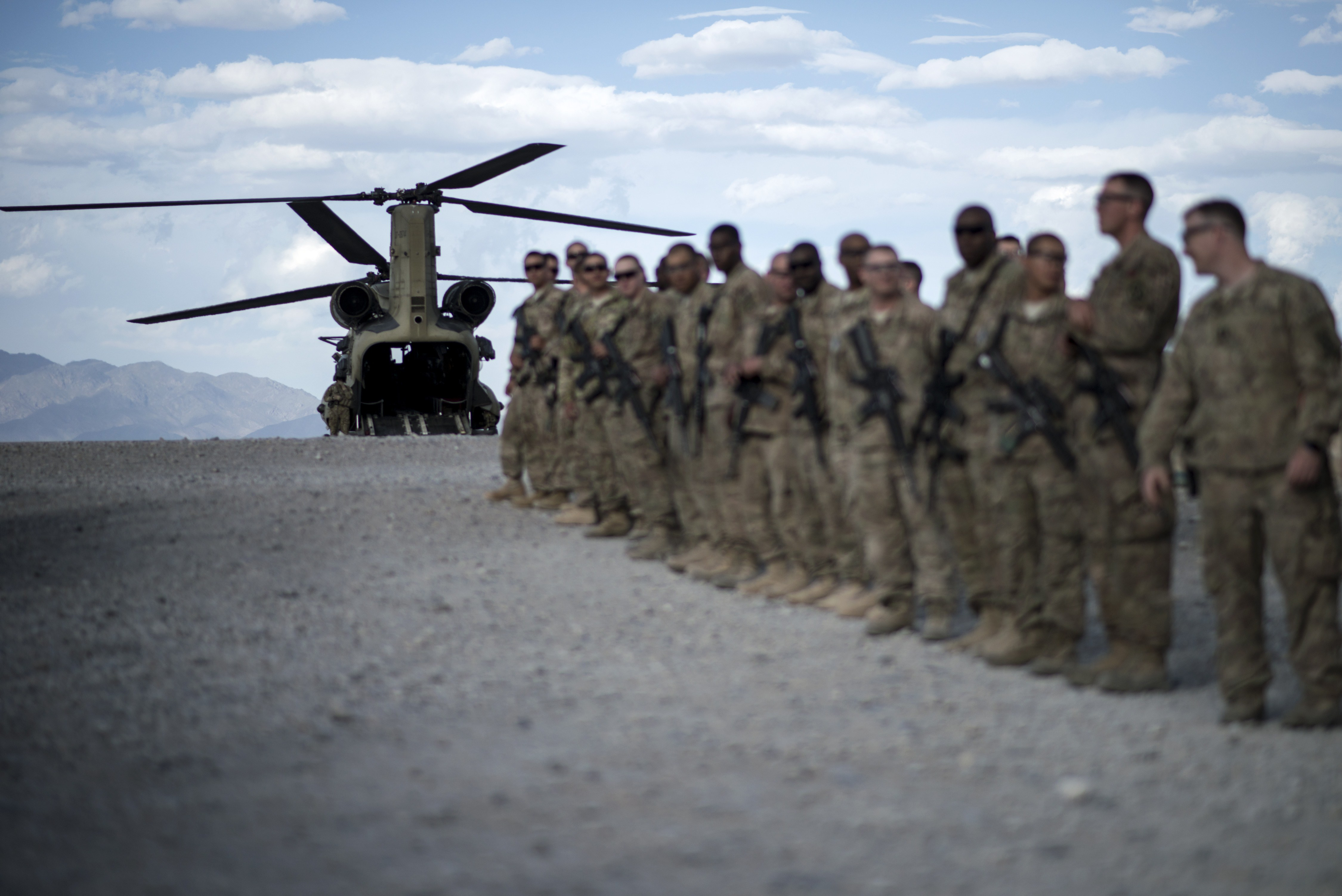 "U.S. soldiers lining up as they wait to bid farewell to wounded veterans during ""Operation Proper Exit"" at Forward Operating Base Shank in Afghanistan's Logar Province on on May 28, 2014. (Brendan Smialowski/AFP/Getty Images)"